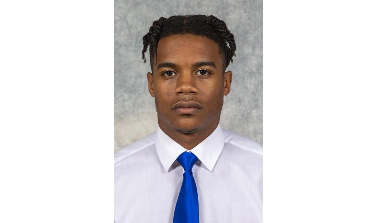 Noah Green is said to be the suspect in the attack outside the U.S. Capitol that killed one police officer and wounded another after ramming them with a vehicle at a security checkpoint barricade. In this photo, Green is wearing a white button up shirt, royal blue tie in a football roster photo for CNU in Virginia.