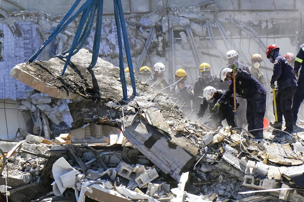 Crews work in the rubble at the Champlain Towers South Condo, Sunday, June 27, 2021, in Surfside, Fla. Many people are still unaccounted for after Thursday's fatal collapse. (AP Photo/Wilfredo Lee)