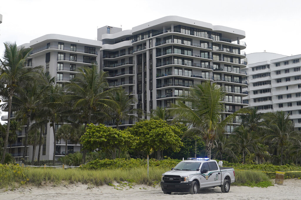 The sister building of the condominium that partially collapsed in Surfside, Fla. This building, erected a year later by the same company, using the same materials and a similar design, has faced the same tides and salty air as the building that collapsed. (AP Photo/Wilfredo Lee, File)