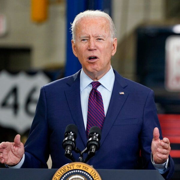 In this June 29, 2021, file photo President Joe Biden speaks about infrastructure spending at the La Crosse Municipal Transit Authority in La Crosse, Wis. President Joe Biden speaks volumes when he whispers. And his whispers during recent public appearances are attracting attention. The White House and communications experts say it's Biden's way of trying to make a connection while emphasizing a point. (AP Photo/Evan Vucci, File)