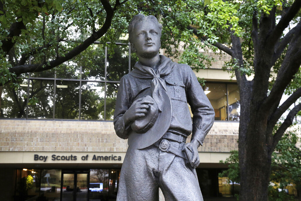 A statue stands outside the Boy Scouts of America headquarters in Irving, Texas. The Boy Scouts of America have reached an agreement with attorneys representing some 60,000 victims of child sex abuse in what could prove to be a pivotal moment in the organization's bankruptcy case. Attorneys for the BSA filed court papers late Thursday, July 1, 2021 outlining a restructuring support agreement, or RSA, with attorneys representing abuse victims. (AP Photo/LM Otero, File)