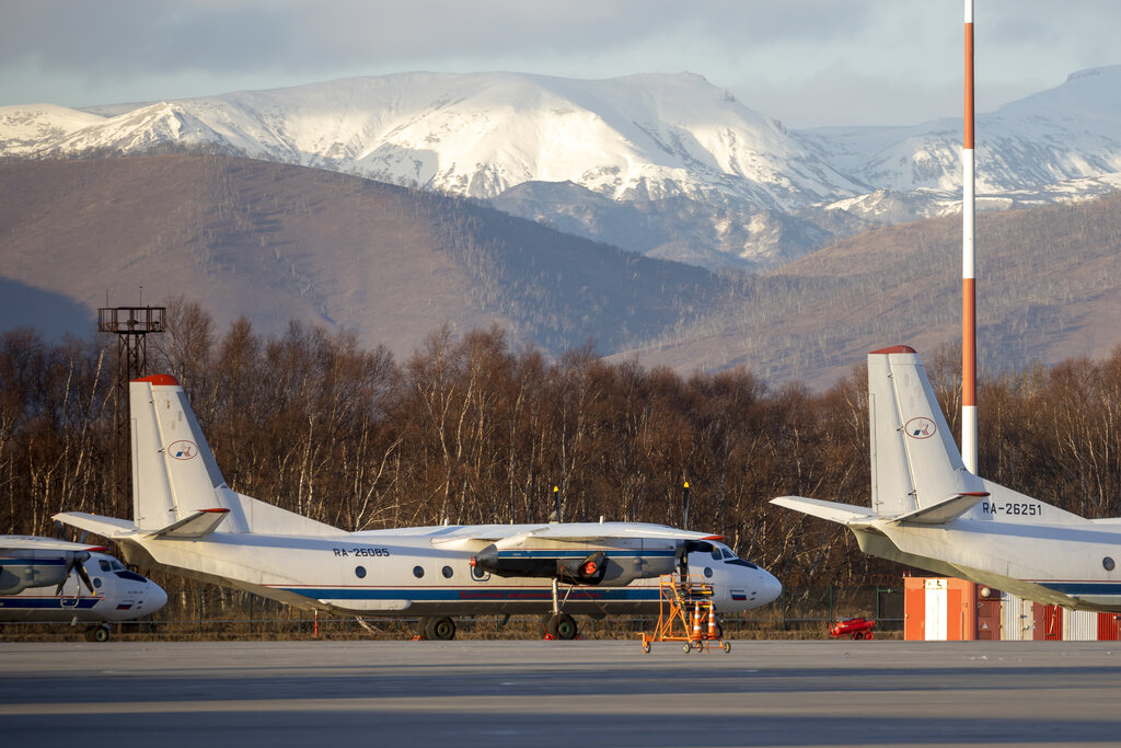 An Antonov An-26 with the same number #RA-26085 as the missed plane is parked at Airport Elizovo outside Petropavlovsk-Kamchatsky, Russia, Tuesday, Nov. 17, 2020. Local officials say the plane with 28 people on board has gone missing in the Russian Far East region of Kamchatka. Emergency officials say the Antonov An-26 plane with 22 passengers and six crew members missed a scheduled communication while it was flying Tuesday from the city of Petropavlovsk-Kamchatsky to the village of Palana. (AP Photo/Marina Lystseva)